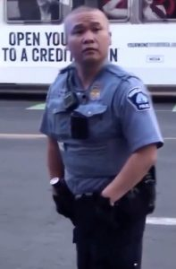 Asian policeman Tou Thao blocked attempts from passers-by to help George Floyd