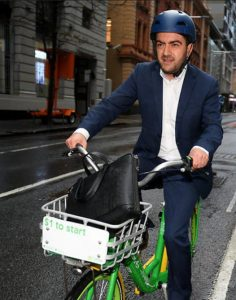 Sam Dastyari on a bike, 526x668