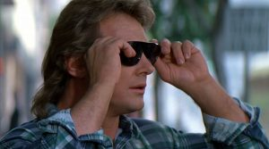 An image from the movie They Live (1988), in which the hero finds a pair of sunglasses which enable him to see the truth about media manipulation