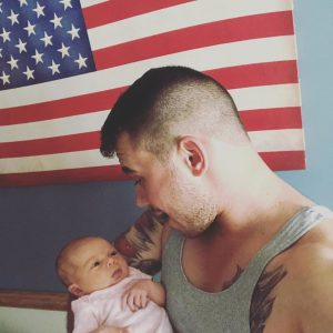 Alex Booth and his baby, who the police threatened to hand over to the notorious CPS