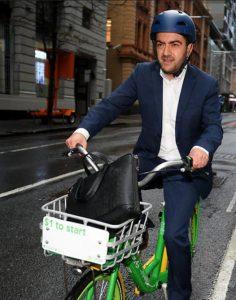Sam Dastyari on a bike, 526x668
