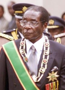 Robert Mugabe, in his role as President of Zimbabwe (wearing not quite as many medals as Idid Amin, but he's trying)